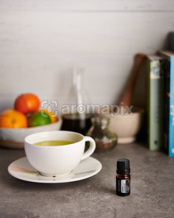 doTERRA Roman Chamomile and chamomile tea with kitchen equipment on a gray stone kitchen bench.