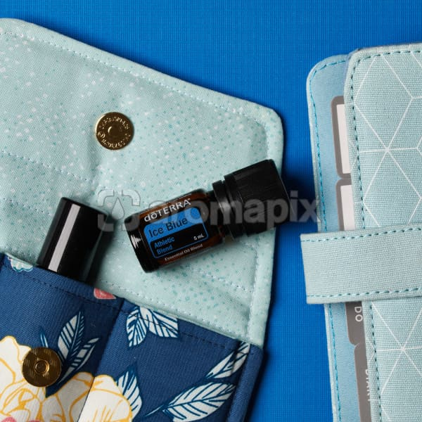 doTERRA Ice Blue on an essential oil bag with a diary on a blue textured background.