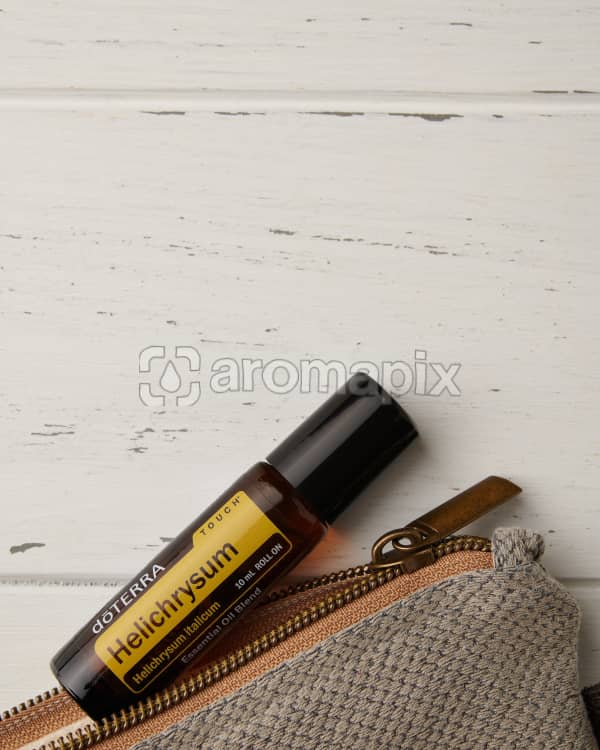 doTERRA Celery Seed and essential oil bag on a white wooden background.