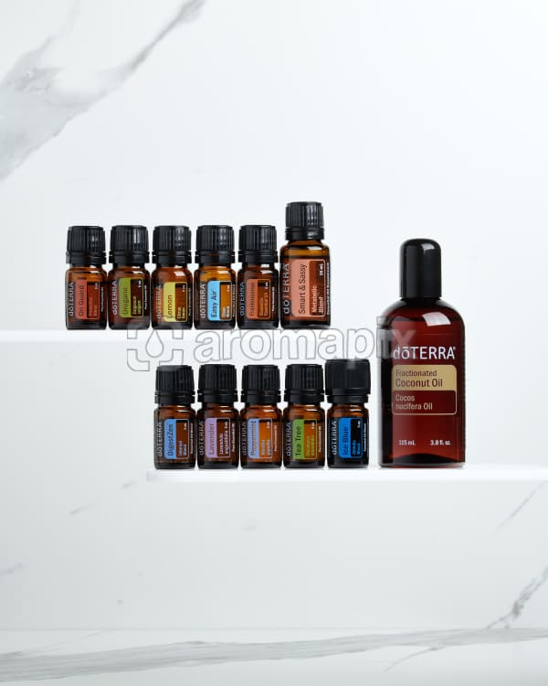 doTERRA Family Essentials Starter Pack with Smart and Sassy on a white marble background.