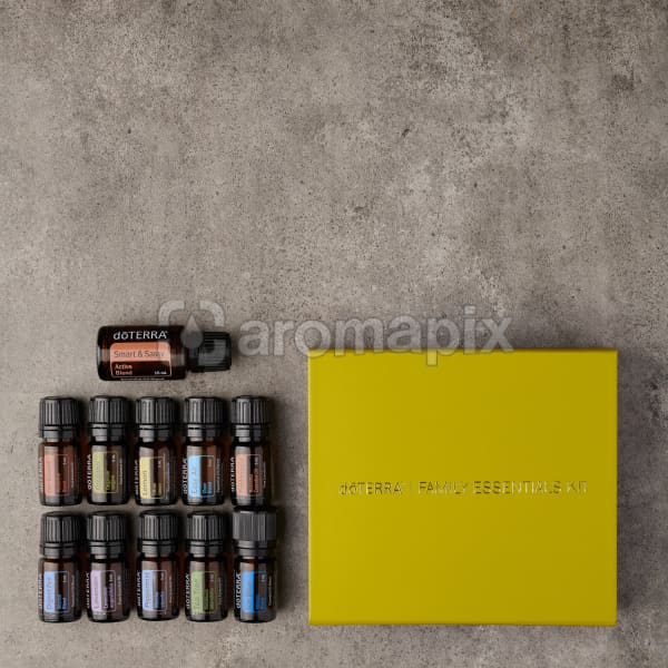 doTERRA Family Essentials Enrolment Kit with Smart & Sassy on a gray stone background.