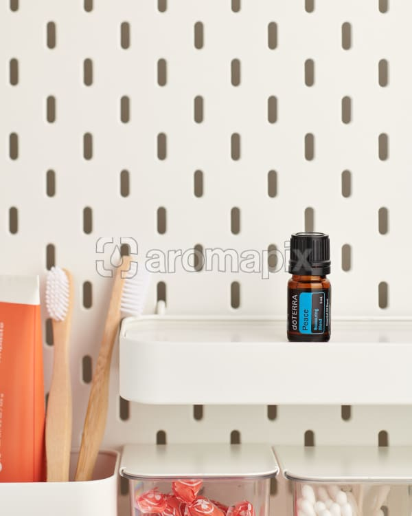 doTERRA Peace Reassuring Blend on a bathroom shelf with additional doTERRA products and bathroom accessories.