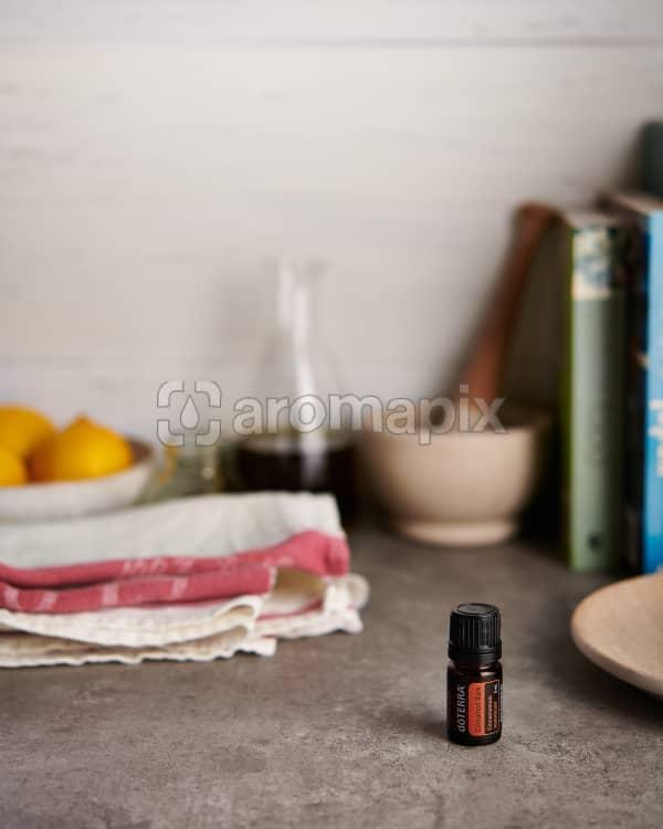 doTERRA Cinnamon with kitchen equipment on a gray stone kitchen bench.