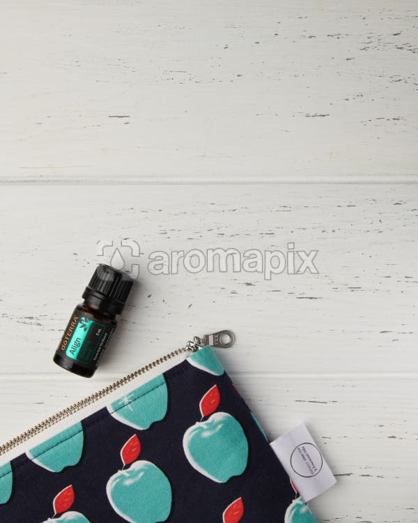doTERRA Align with an essential oil bag on a white wooden background.