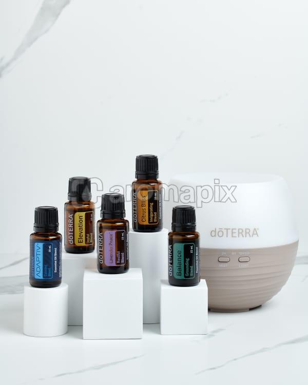 doTERRA Emotional Wellness Starter Pack standing on white blocks on a white marble background.