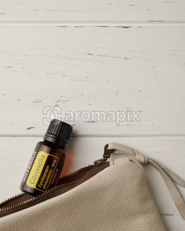 doTERRA Citronella and essential oil bag on a white wooden background.