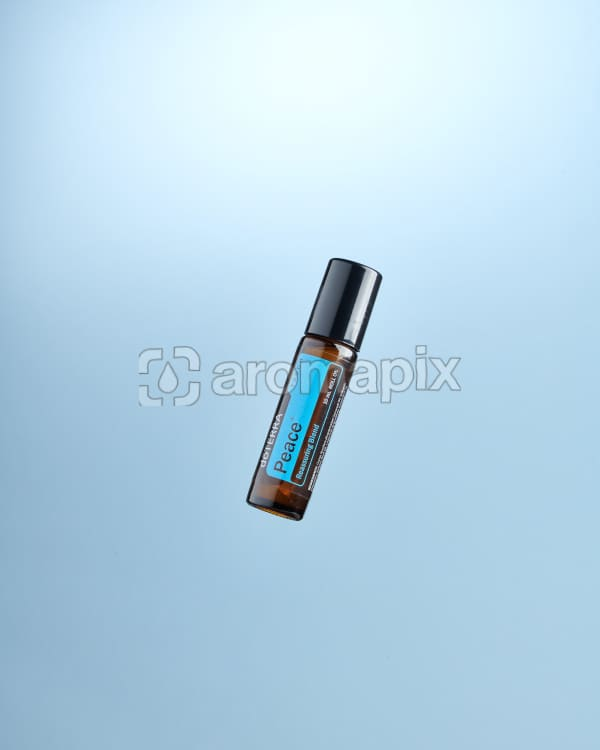 doTERRA Peace Touch floating on a pale blue background.