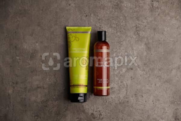 doTERRA Salon Essentials Shampoo and Conditioner on a gray stone bathroom bench.
