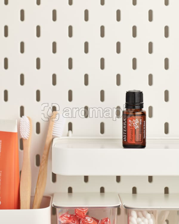 doTERRA Harvest Spice Gathering Blend on a bathroom shelf with additional doTERRA products and bathroom accessories.