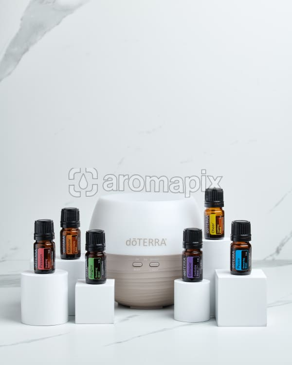 doTERRA Emotional Aromatherapy Starter Pack on white blocks on a white marble background.