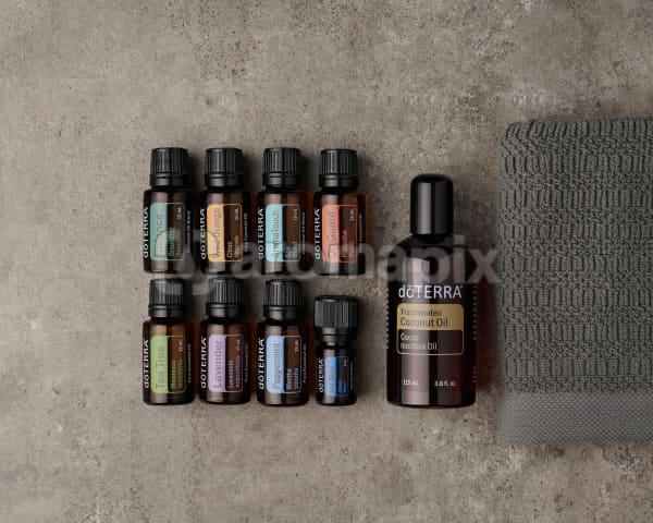 doTERRA AromaTouch Pro Enrolment Kit on a gray stone background.