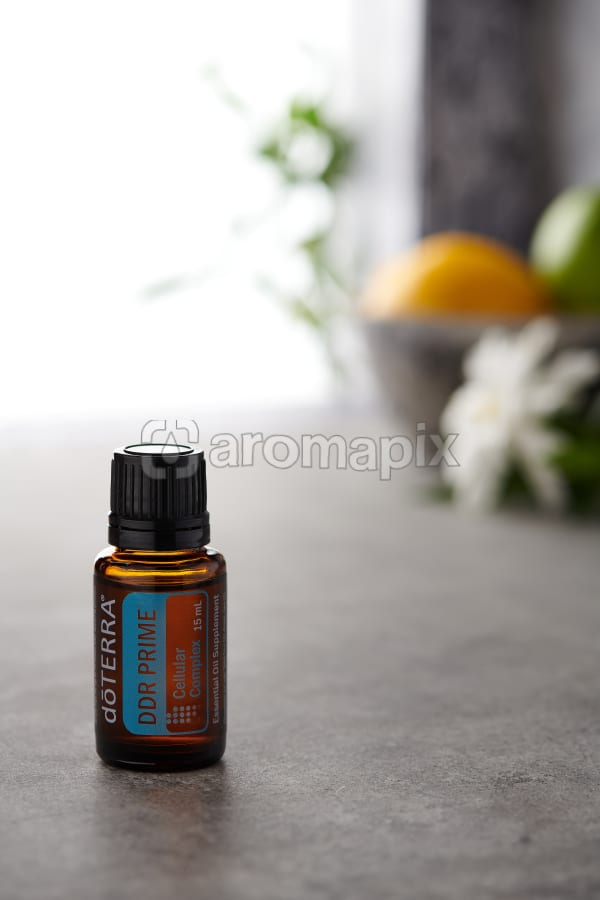 doTERRA DDR Prime on a bench in a rustic setting near a window.