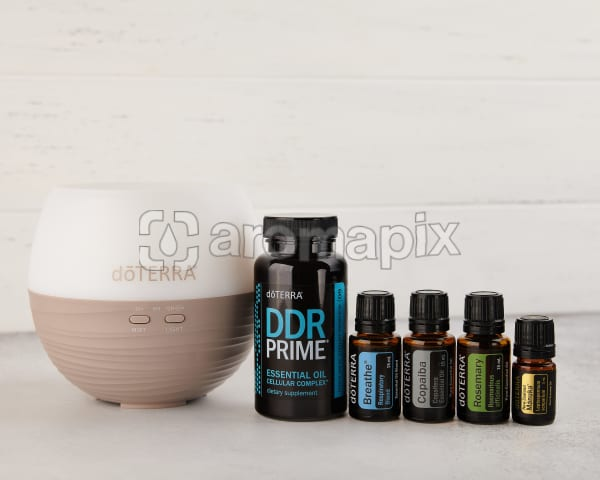 doTERRA US Winter Protection Kit containing a Petal Diffuser 2.0, DDR Prime Softgels, Breathe, Copaiba, Rosemary and Manuka on a white background.