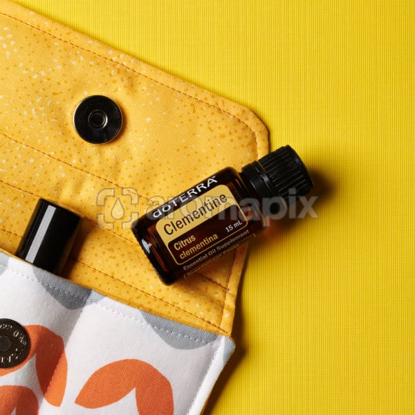 doTERRA Clementine on an essential oil bag on a yellow textured background.