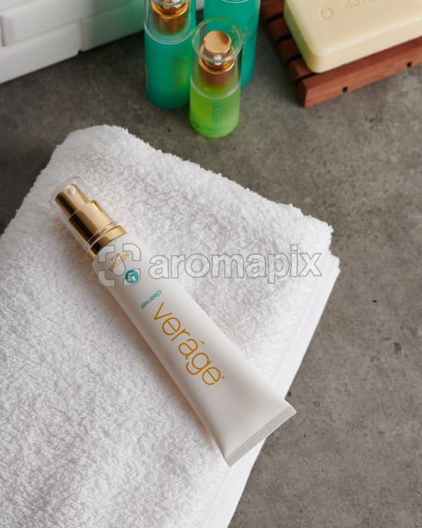 doTERRA  Verage Cleanser with a white fluffy towel on a stone bathroom bench top.
