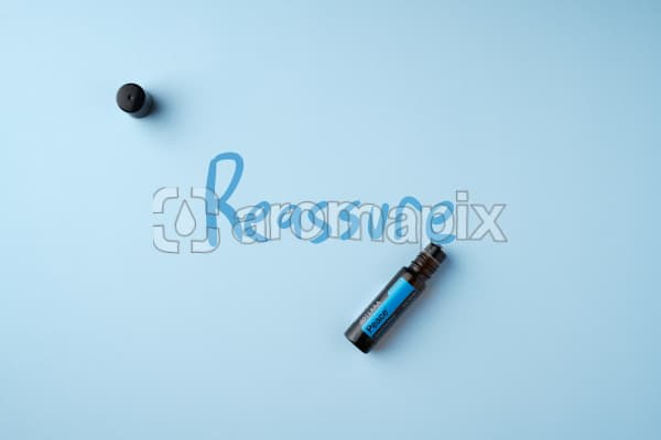 """doTERRA Peace Touch on a light blue colored background with hand written """"Reassure""""."""