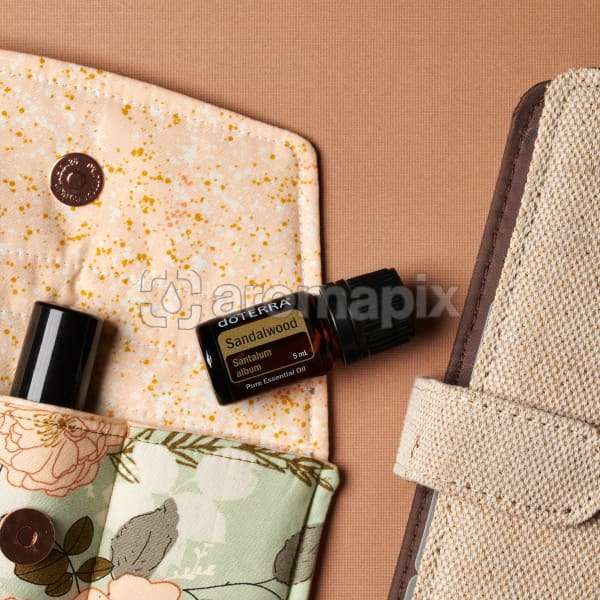 doTERRA Sandalwood on an essential oil bag with a diary on a brown textured background.