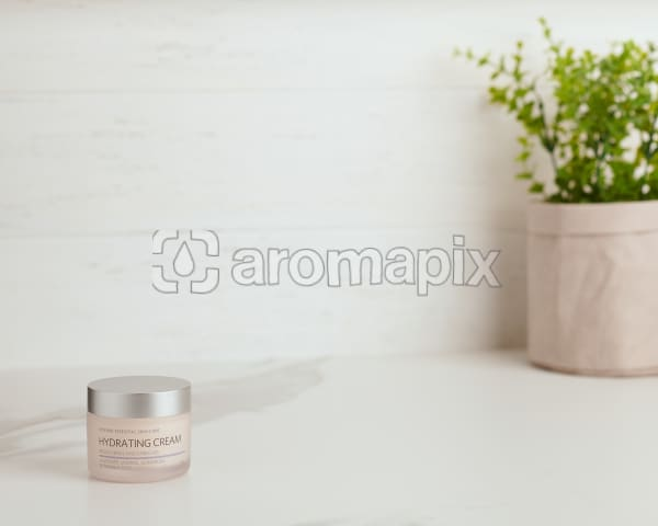 doTERRA Essential Skin Care Hydrating Cream sitting on a white marble bench near a pot plant.