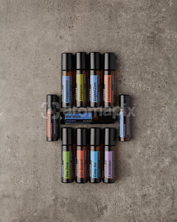 doTERRA Touch Enrolment Kit on a gray stone background.