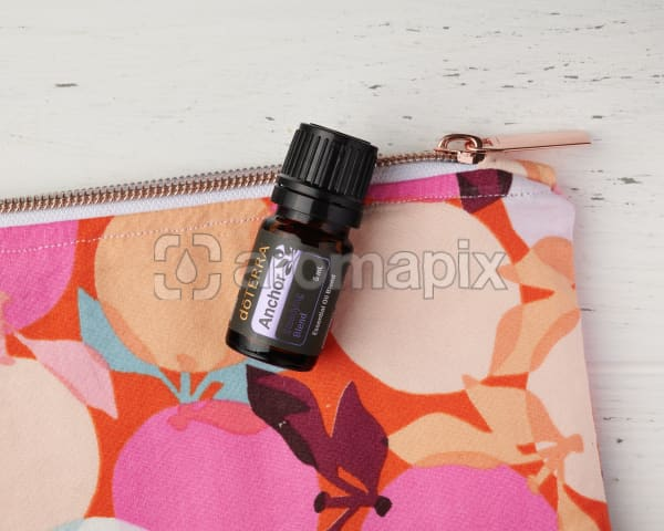 doTERRA Anchor in close up on an essential oil bag on a white wooden background.