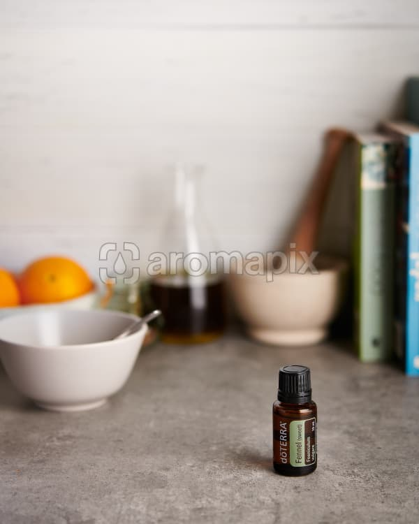 doTERRA Fennel with kitchen equipment on a gray stone kitchen bench.
