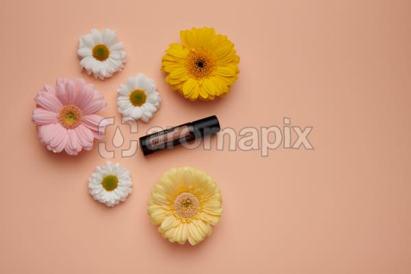 doTERRA Neroli Touch with flowers on a pale orange card stock background.