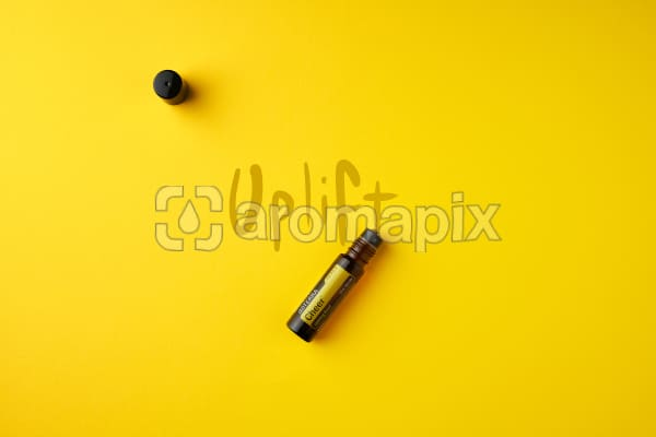 """doTERRA Cheer Touch on a gold colored background with handwritten """"Uplift""""."""