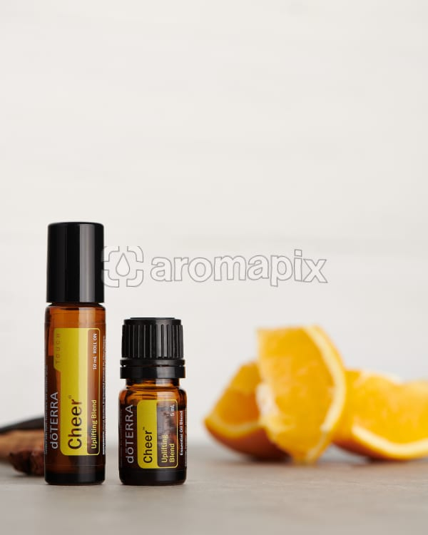 doTERRA Cheer Touch and Cheer with ingredients on a white background.