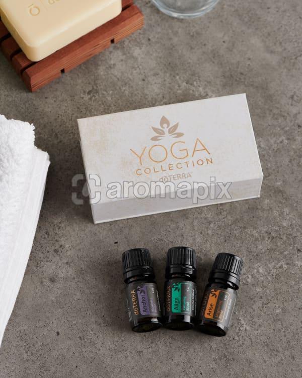 doTERRA Yoga Collection on a gray stone bathroom bench top.