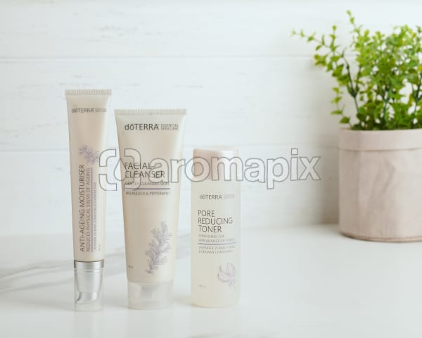 doTERRA Essential Skin Care Anti-Ageing Moisturiser, Facial Cleanser and Pore Reducing Toner sitting on a white bench.