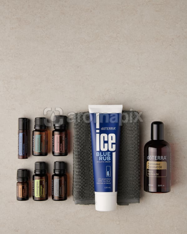 doTERRA Active Sports Wellness Box with a towel on a marble benchtop with copy space to add your message.