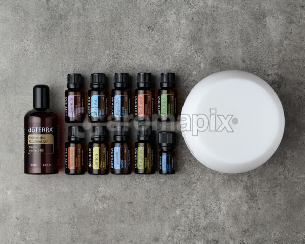 doTERRA Home Essentials Starter Pack on a gray stone background.
