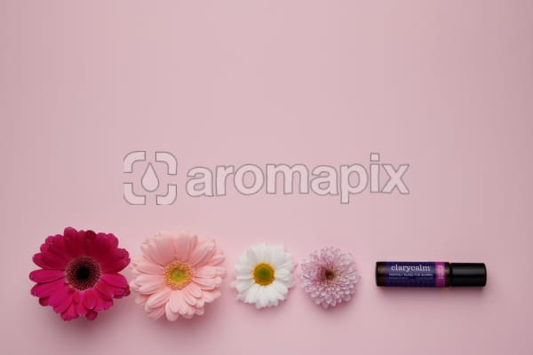 doTERRA ClaryCalm with flowers on a pale pink card stock background.