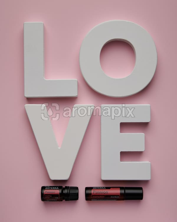 doTERRA Passion and Passion Touch with the letters L O V E on a pink background.