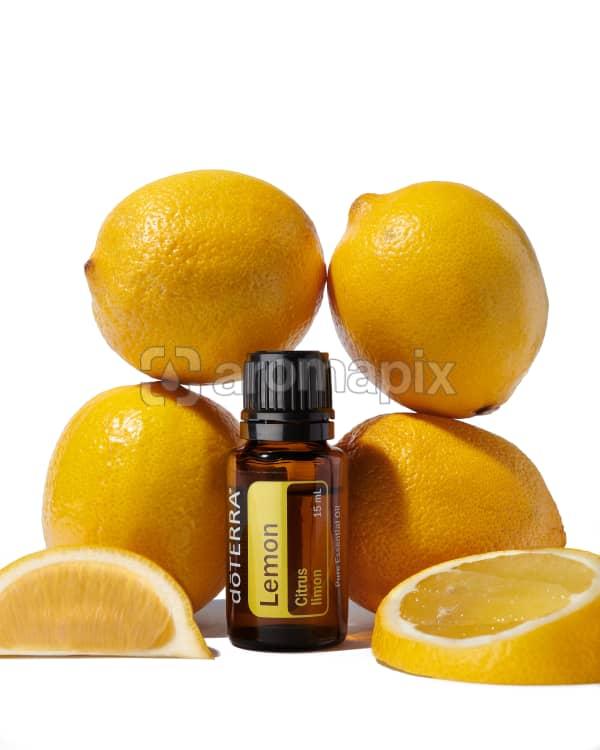 doTERRA Lemon surrounded by lemons on a white background.