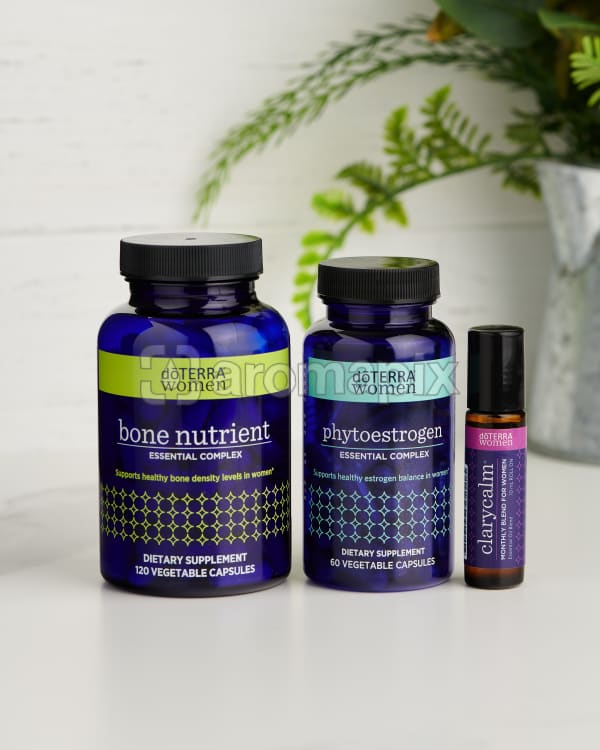 doTERRA Bone Nutrient Essential Complex, Phytoestrogen Essential Complex and Clary Calm and greenery on a white benchtop.