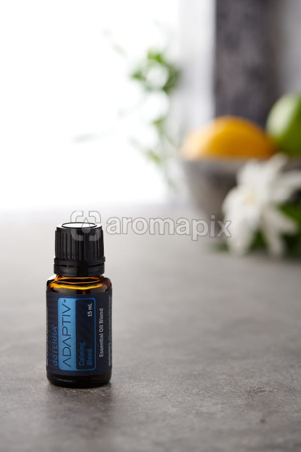 doTERRA Adaptiv on a bench in a rustic setting near a window.