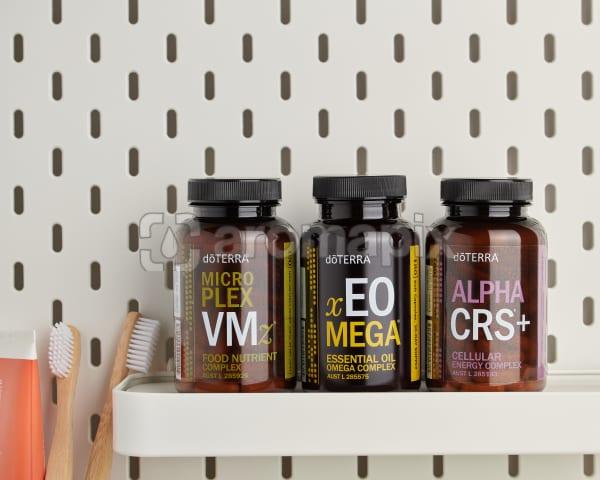 doTERRA Microplex VMz, xEO Mega and Alpha CRS+ on a bathroom shelf with bathroom accessories.