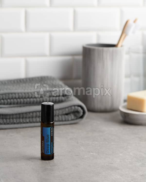 doTERRA Deep Blue Touch with bathroom acessories on a bathroom bench top.