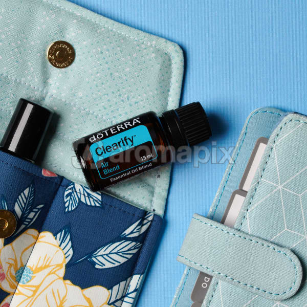 doTERRA Clearify on an essential oil bag with a diary on a blue textured background.