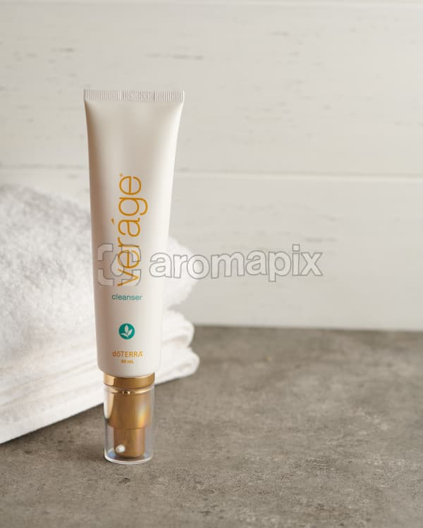 doTERRA Verage Cleanser with a white towel on a stone bathroom bench top.