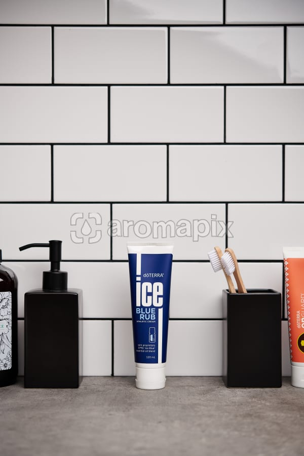 doTERRA  Ice Blue Rub with bathroom accessories on a stone bathroom benchtop.