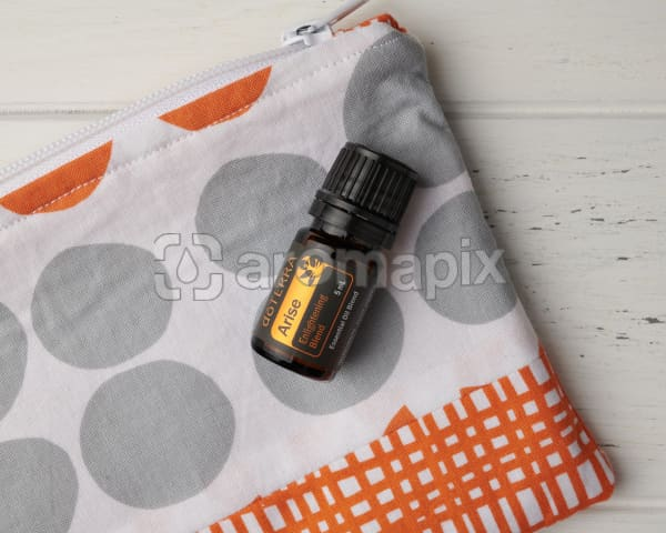 doTERRA Arise in close up on an essential oil bag on a white wooden background.