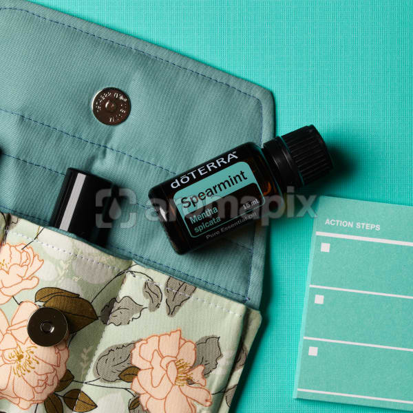 doTERRA Spearmint on an essential oil bag and a to do list on a turquiose blue textured background.