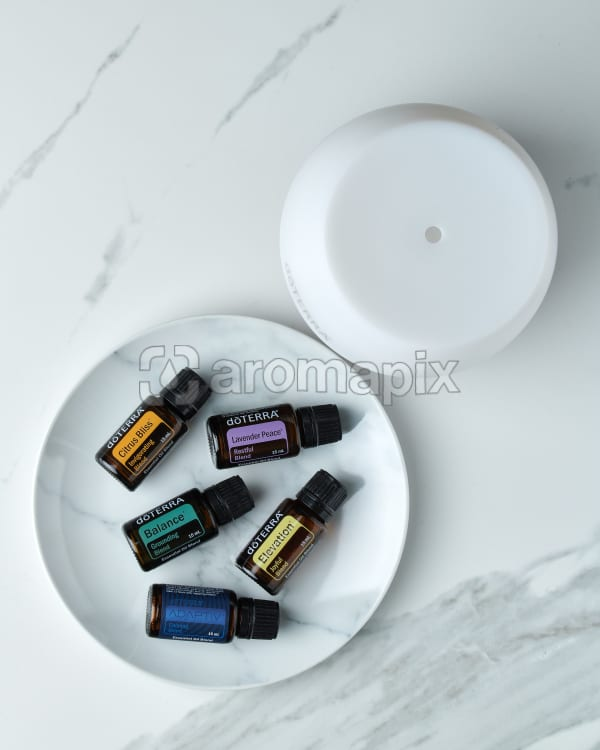 doTERRA Emotional Wellness Starter Pack on a white marble background.