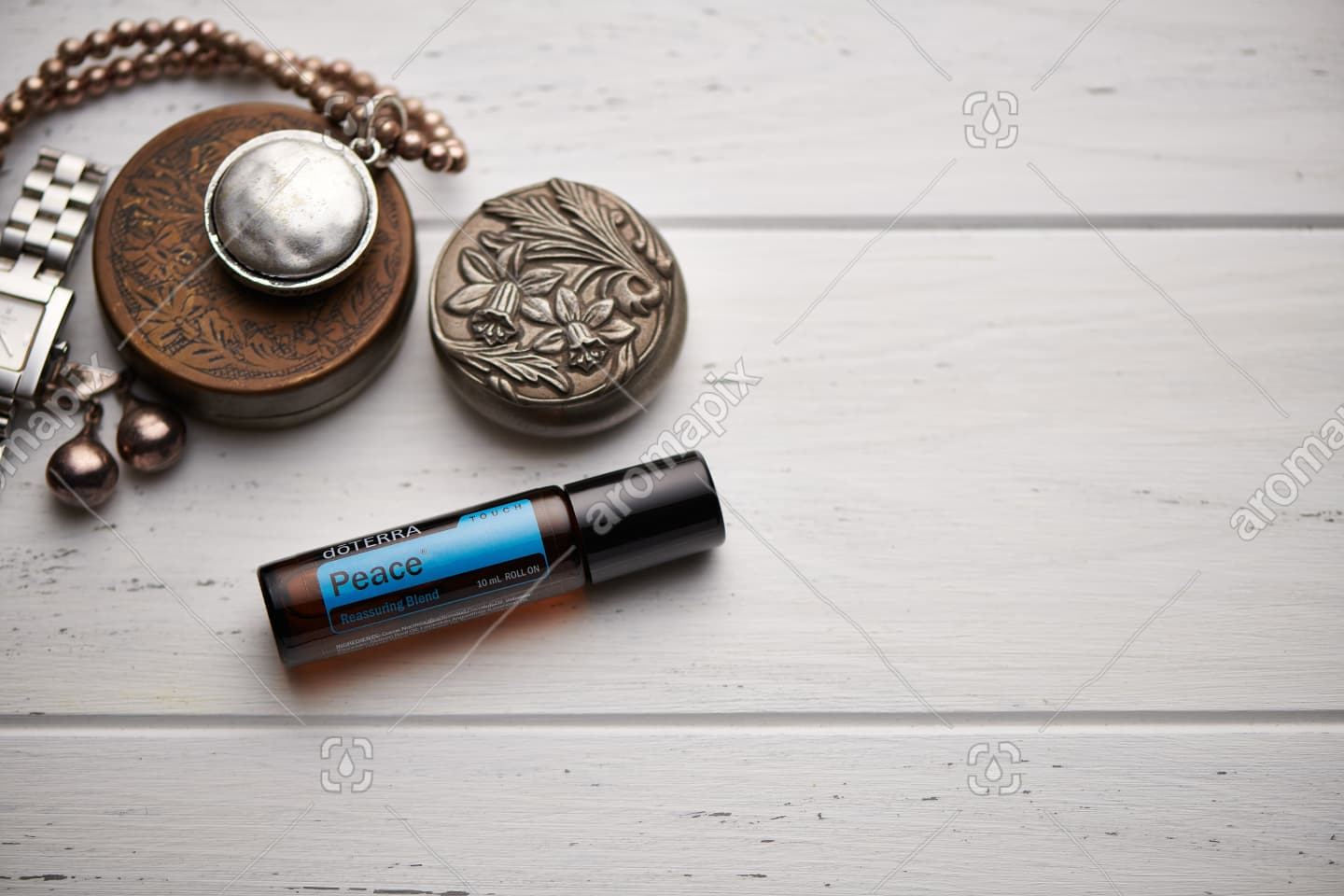 doTERRA Peace Touch on rustic background