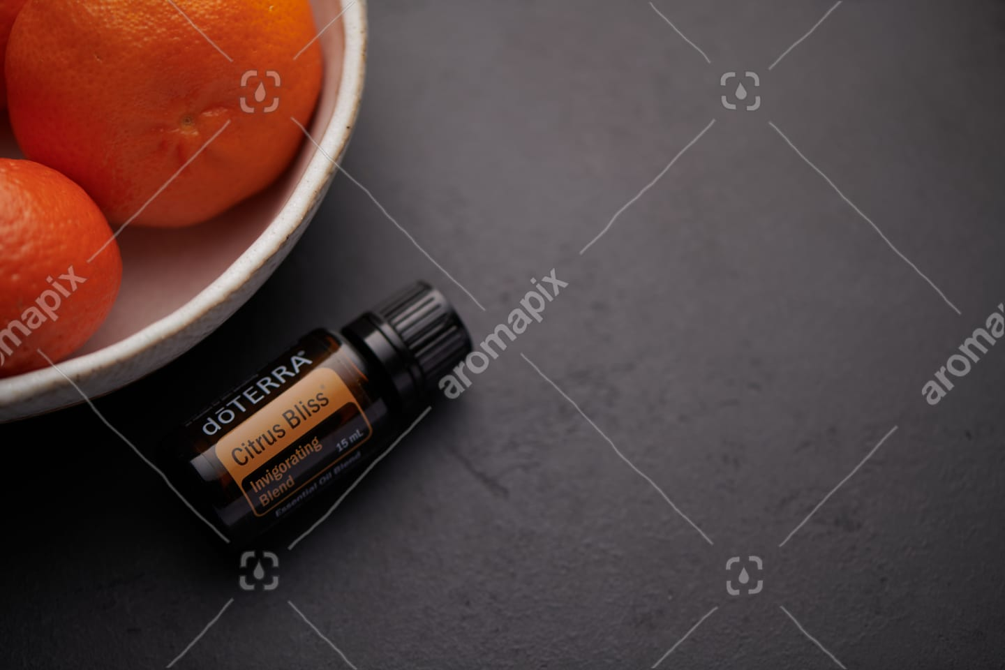 doTERRA Citrus Bliss product and citrus fruit in white bowl