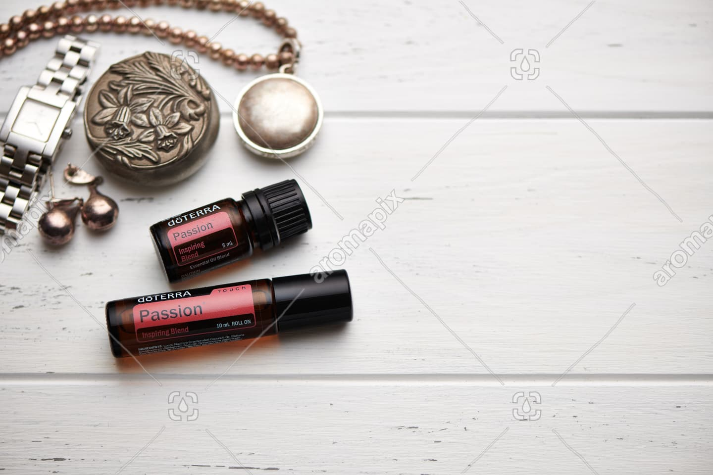 doTERRA Passion and Passion touch on rustic background