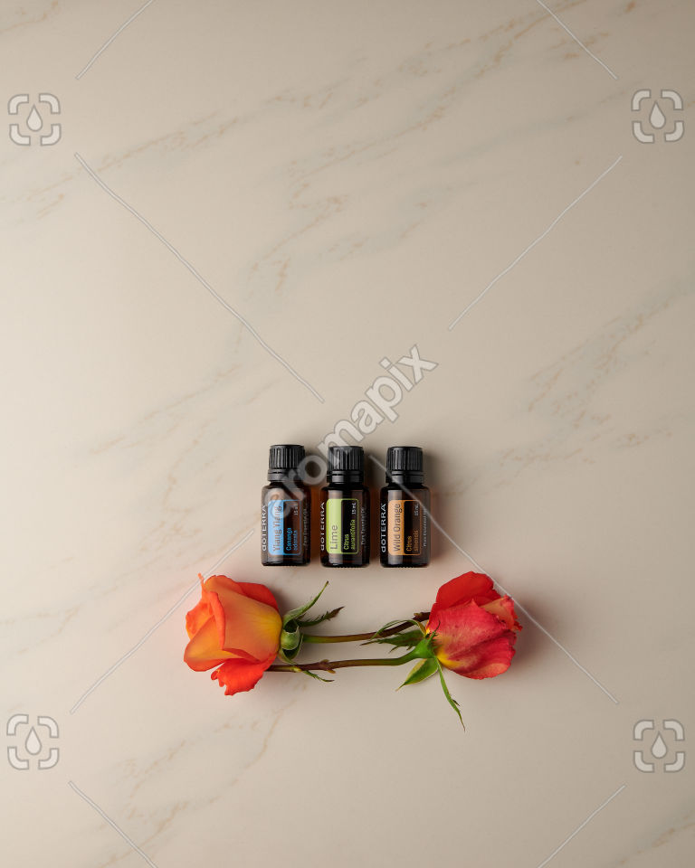 doTERRA Ylang Ylang, Lime and Wild Orange with roses on white