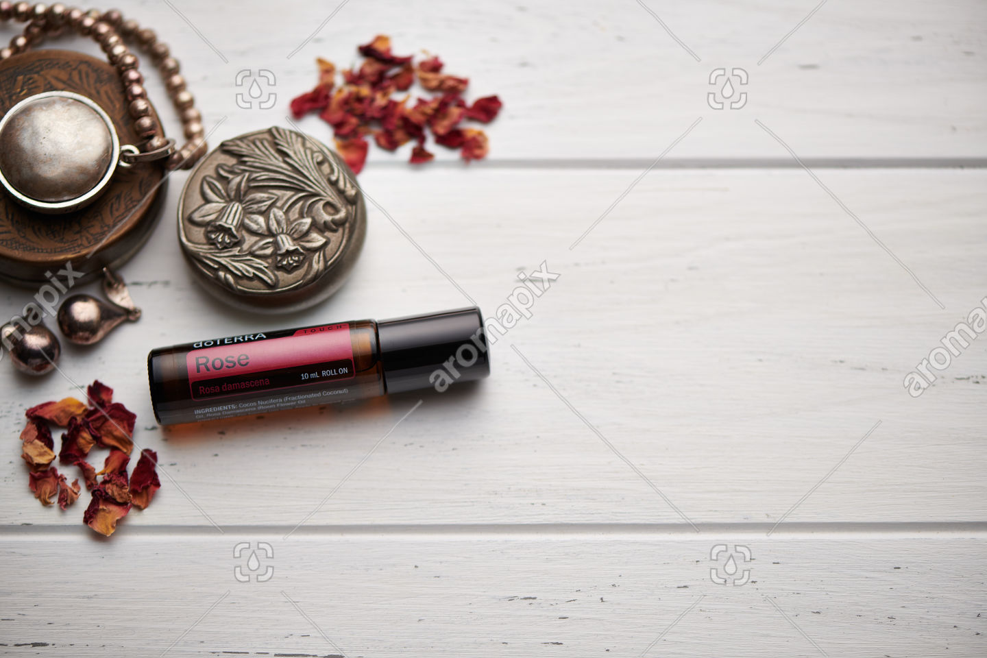 doTERRA Rose Touch on rustic background